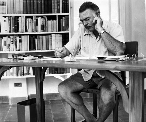 Hemingway_at_his_writing_desk_