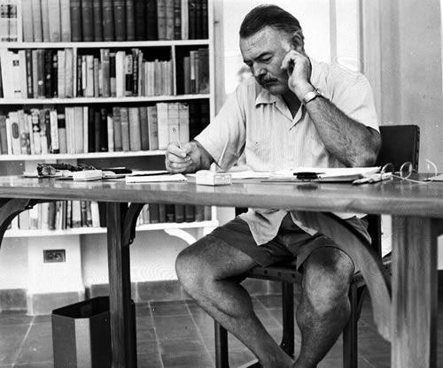 Hemingway_at_his_writing_desk_