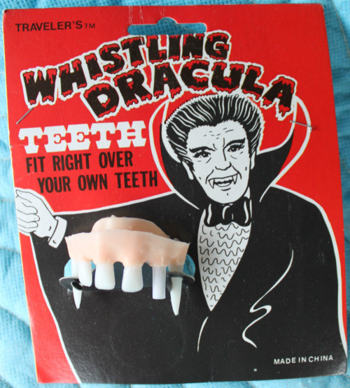 Whistling dracula teeth for halloween