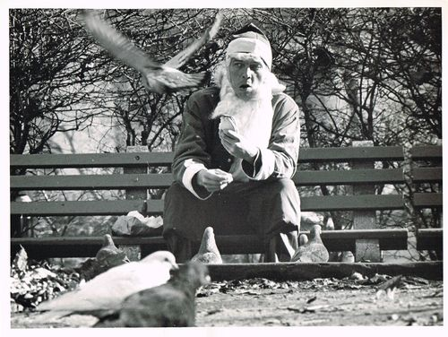 Santa claus feeding pidgeons